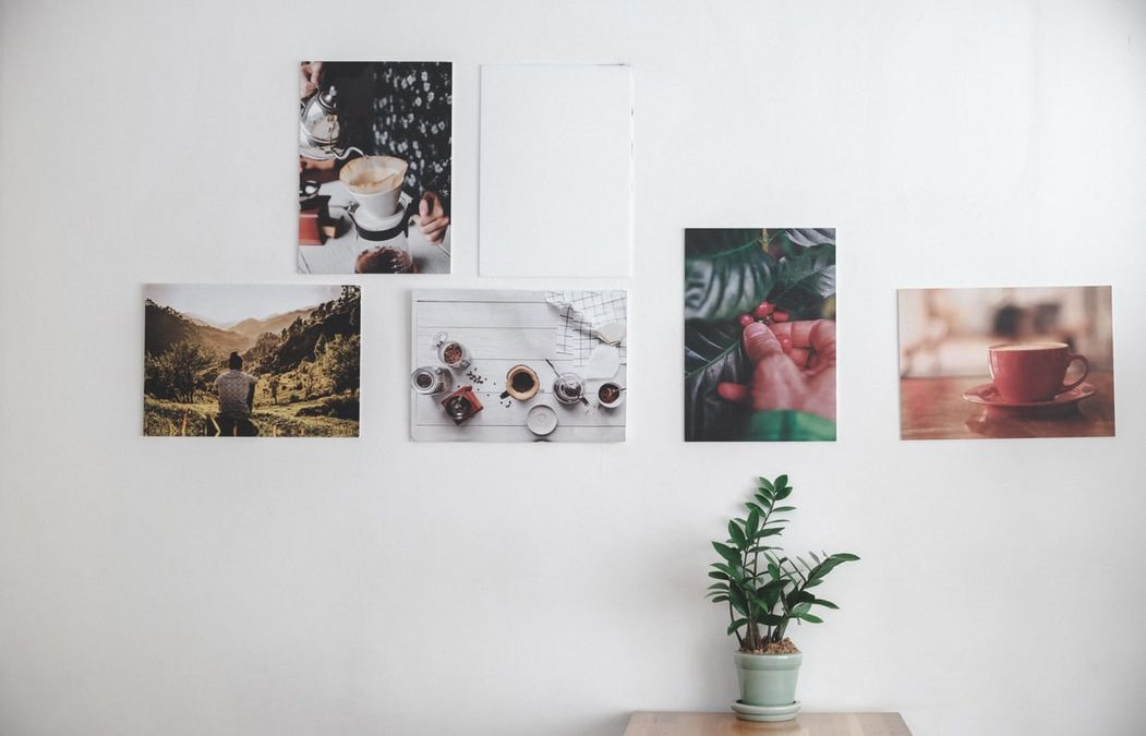 white wall with photographs